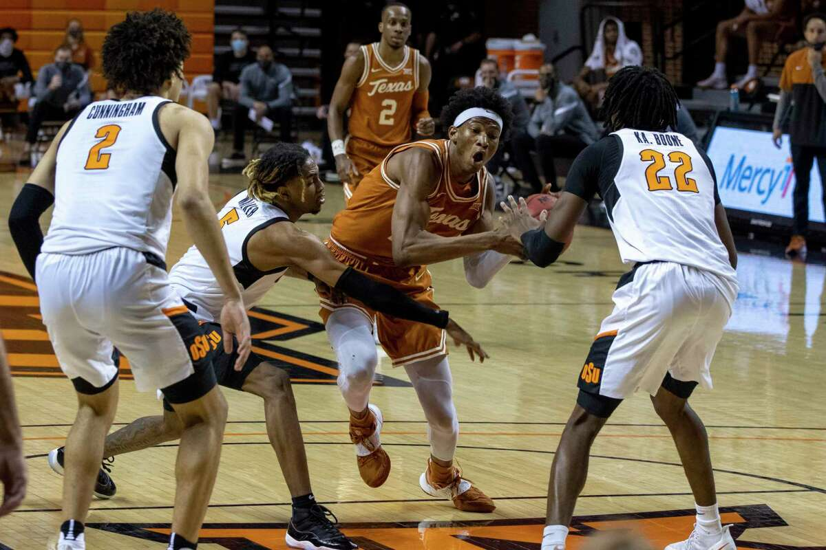 For Texas and forward Kai Jones (22), there was no getting past Oklahoma State on Saturday, with the Longhorns falling 75-67 in double overtime.