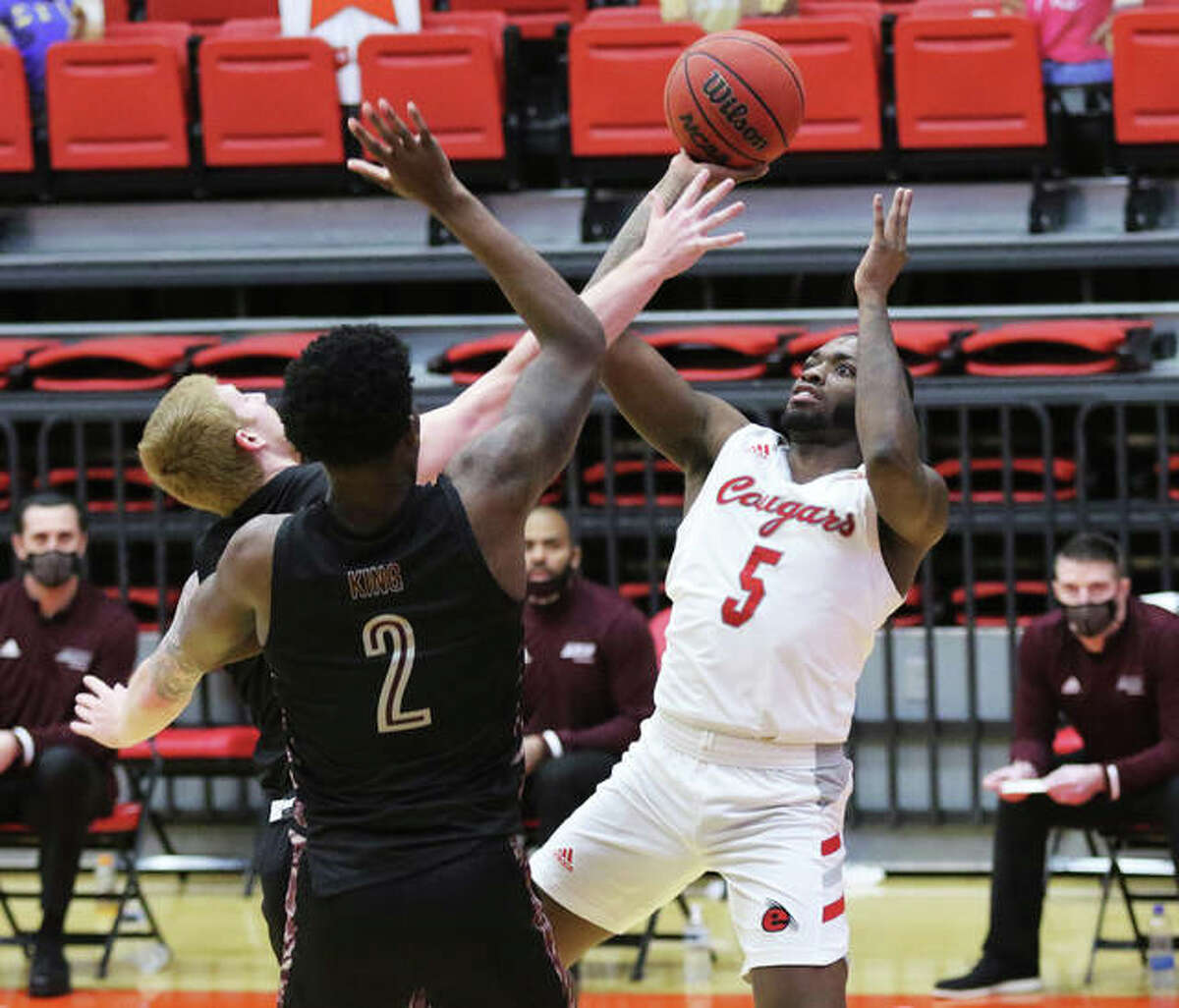 SIUE's Carlos Curtis (5) draws a foul on his shot over Eastern Kentucky defenders on Monday afternoon at First Community Arena in Edwardsville.