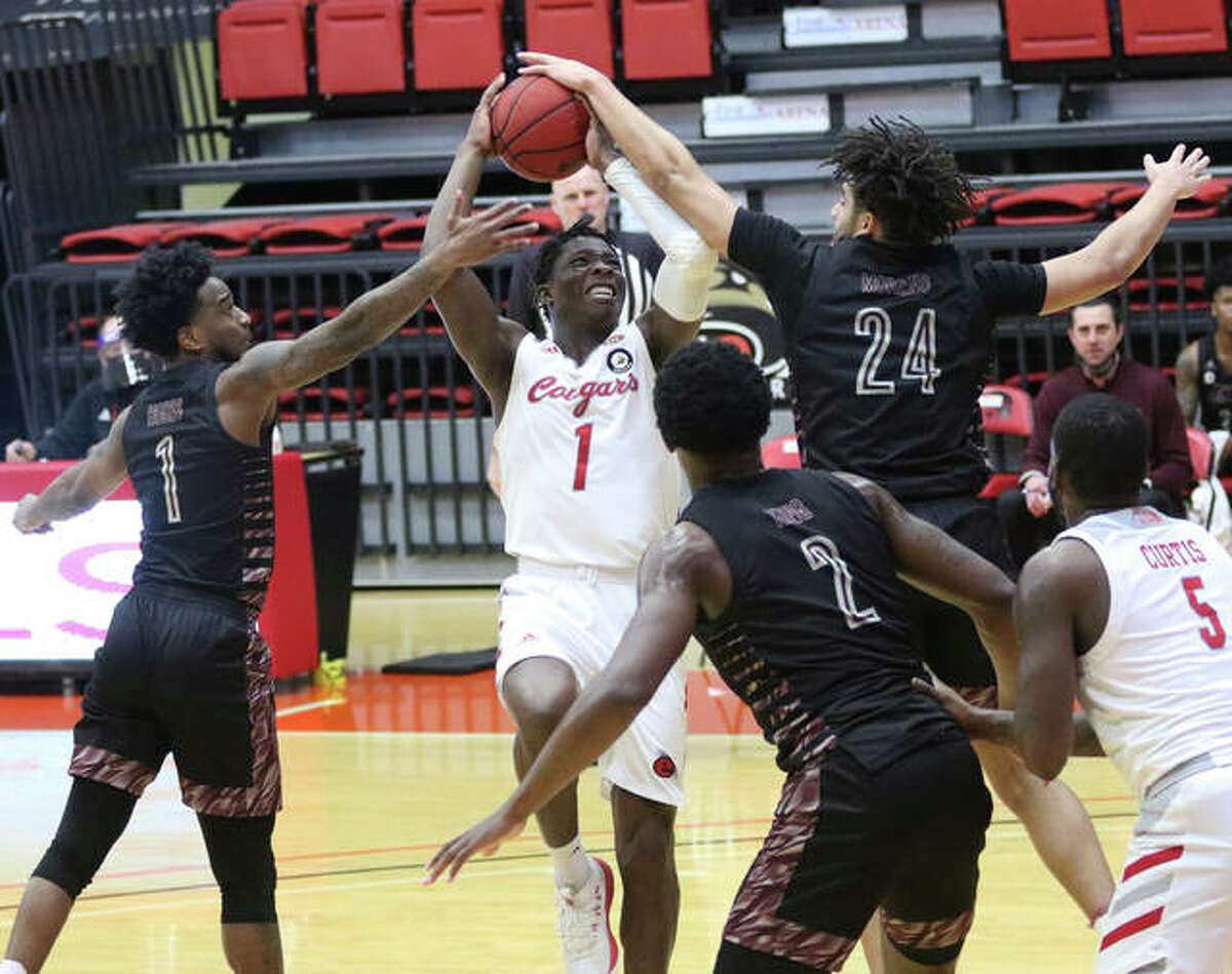 SIUE's Mike Adewunmi (1) drives into the heart of Eastern Kentucky's defense and draws a foul in the first half Monday afternoon at First Community Arena in Edwardsville.