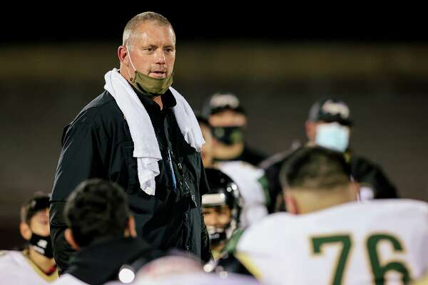 Southwest Legacy coach John Tarvin speaks to the Titans at the conclusion of their Class 5A Division I second round playoff game with Corpus Christi Veterans Memorial on Dec. 18. Tarvin, 56, announced in February he was stepping down as football coach and athletic coordinator at Southwest Legacy after coaching the Titans for three seasons, completing a 30-year coaching career.