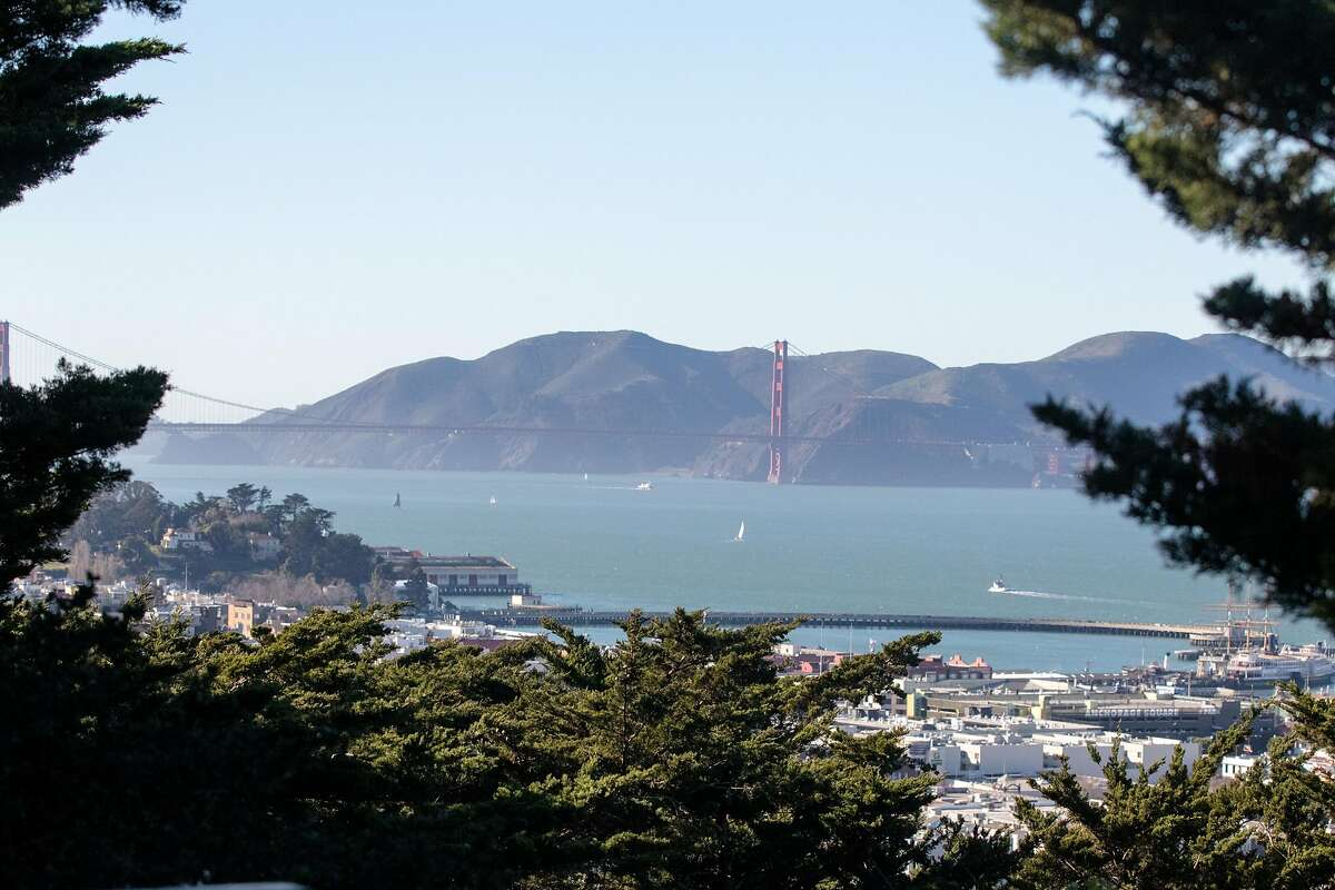 The Golden Gate Bridge is visible from the parking lot of Coit Tower in San Francisco on Feb. 5, 2021.
