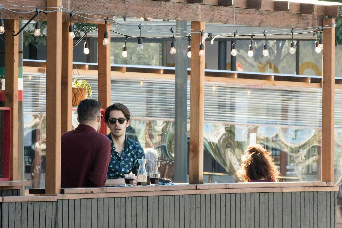 People dine outdoors in the North Beach neighborhood of San Francisco on Feb. 5, 2021.