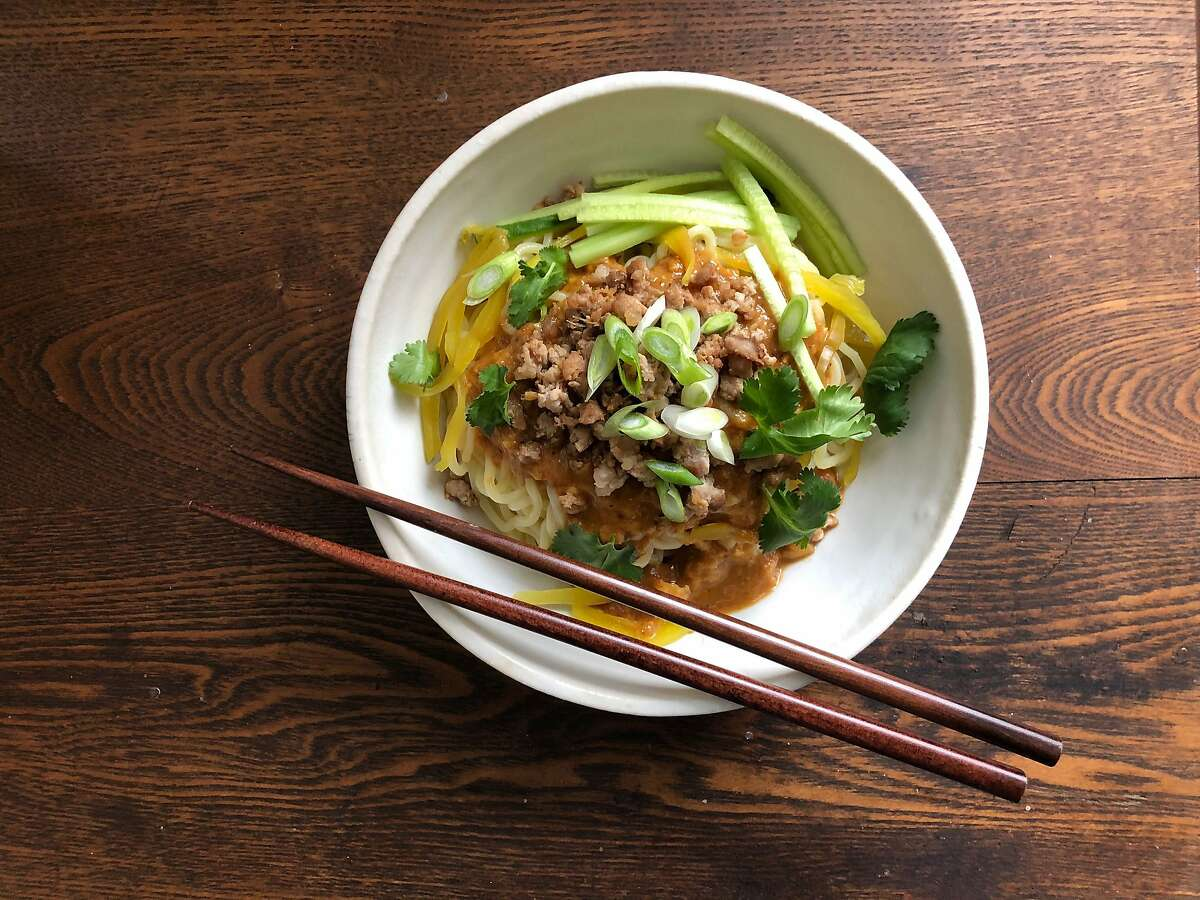 Sichuan peppercorns, balanced by a hint of peanut butter, provide the heat in Dan Dan Noodles With Pork.