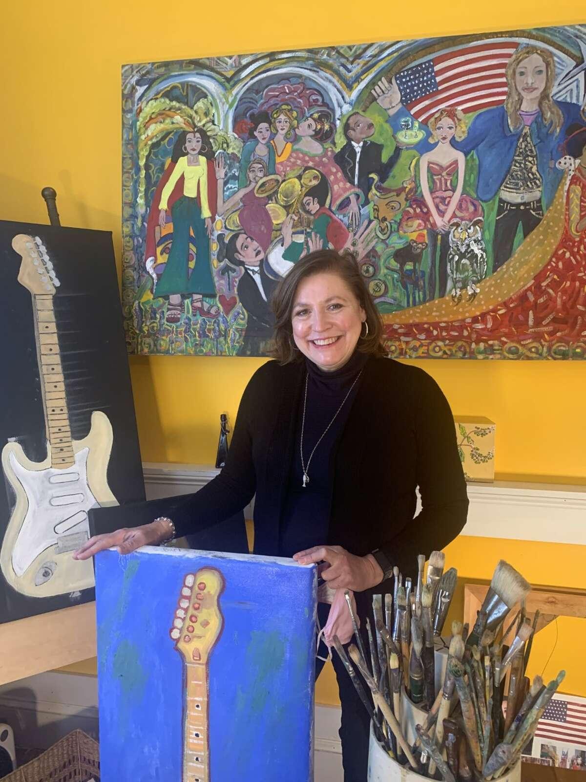 "Brigid Rockwell' with ""The Coronation of Kamala"" and her guitar paintings. (credit: Joseph Dalton)"