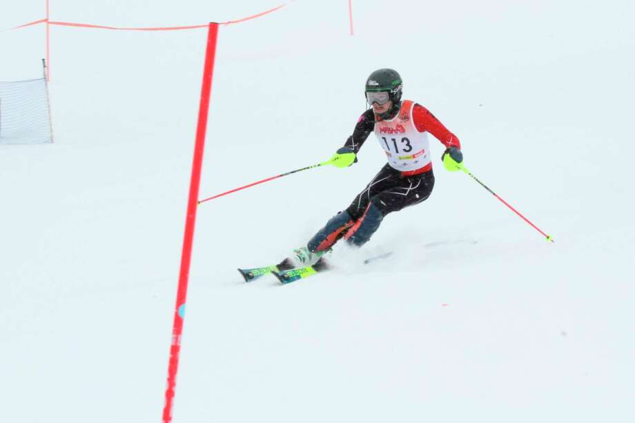 Seth Johnson speeds down the hill to earn a top 10 finish in the region in the slalom on Feb. 8. (Robert Myers/Record Patriot)