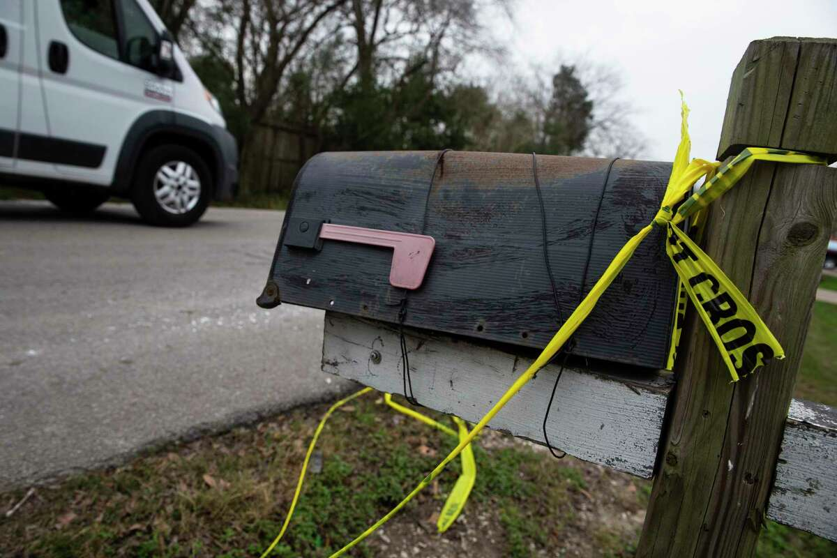 Police crime scene tape is left on a mailbox in the 8600 block of Rayson Road from a fatal shooting over the weekendMonday, Feb. 8, 2021, in Houston. Stacey Berghoff, 35, was digging through piles of discarded furniture around 4:45 a.m. Saturday in the 8600 block of Rayson Road, according to HPD. She was shot and killed following a road rage clash when the suspected shooter followed her over a blocked car.