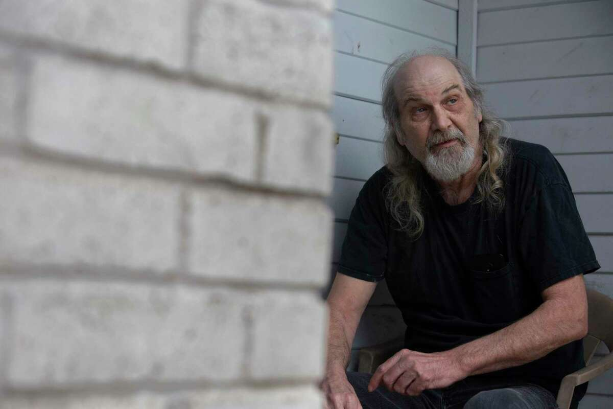 Randy Husmann talks about Stacey Berghoff, who's been staying with him and taking care of him in the past year, at his front porch in Monday, Feb. 8, 2021, in Houston. Berghoff, 35, was digging through piles of discarded furniture around 4:45 a.m. Saturday in the 8600 block of Rayson Road, according to HPD. She was shot and killed following a road rage clash when the suspected shooter followed her over a blocked car.