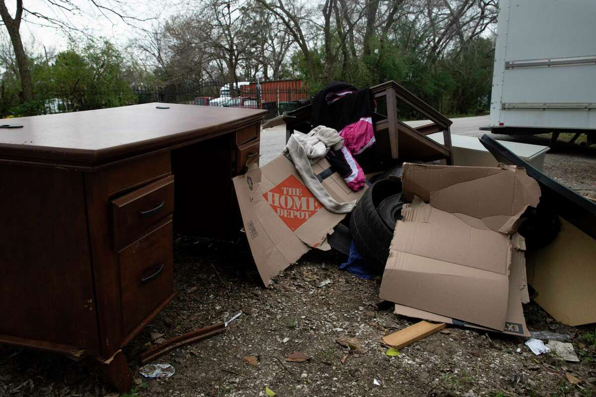 Stacey Berghoff and a friend were picking through this pile of discarded furniture in the 8600 block of Rayson Road around 4:45 a.m. Saturday when a road rage clash ensued.