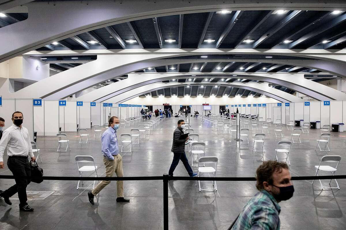 Chairs are seen socially distanced from one another ahead of the opening of a mass COVID-19 vaccination site at Moscone South in San Francisco.