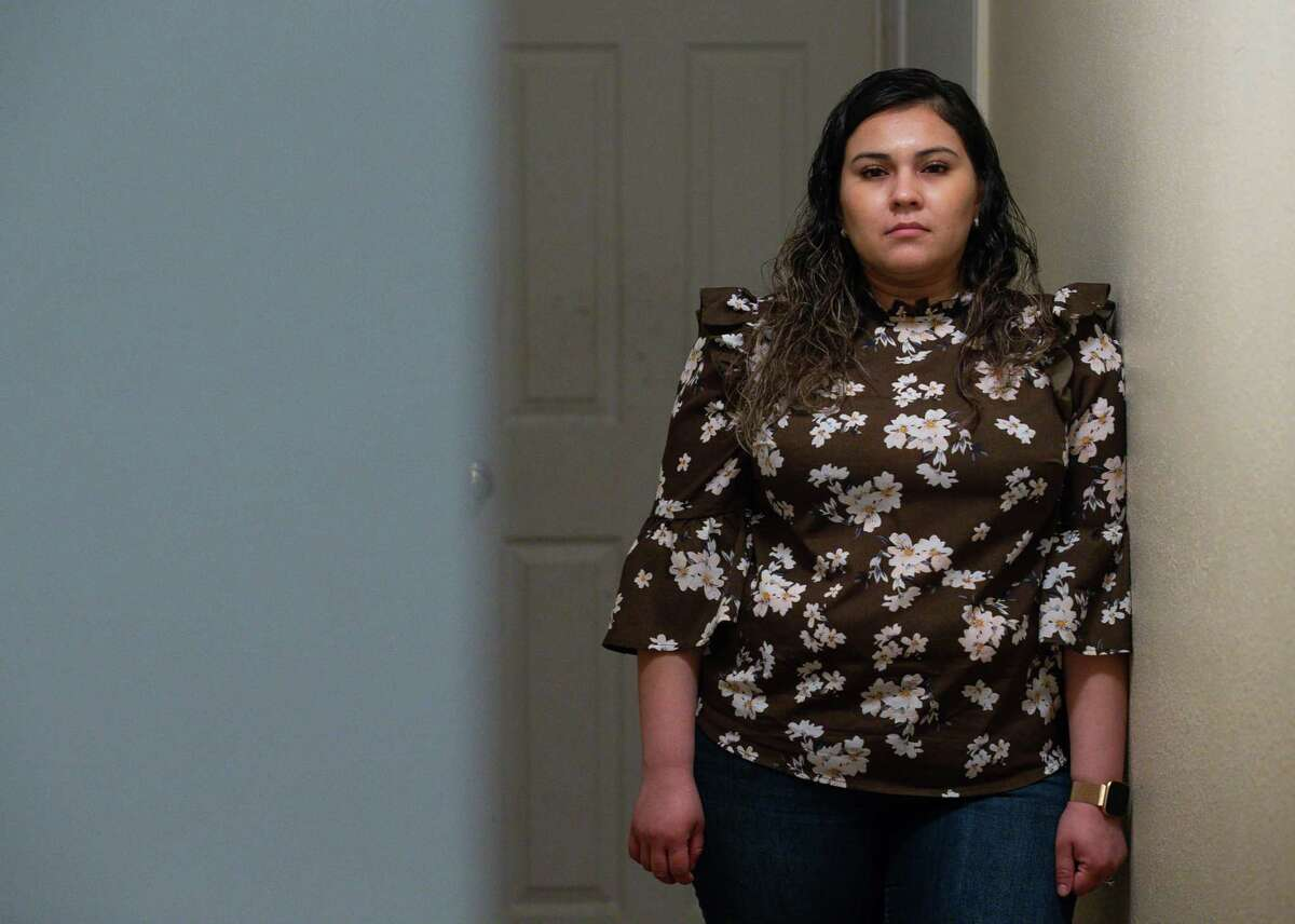Vanessa Rodriguez poses for a photograph inside her home Wednesday, Feb. 3, 2021, in Crosby, Texas. Rodriguez, from Mexico, has been thinking about applying for DACA for many years, but it wasn't until president Joe Biden took office that she finally felt safe to do so. As a mother of three American children, she was afraid of giving her information to the government and being deported. Now she and her husband are among the many DACA eligible people that are applying for the first time.