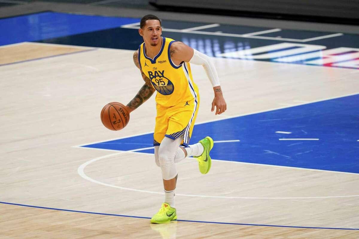 Golden State Warriors' Juan Toscano-Anderson handles the ball during an NBA basketball game against the Dallas Mavericks in Dallas, Thursday, Feb. 4, 2021. (AP Photo/Tony Gutierrez)
