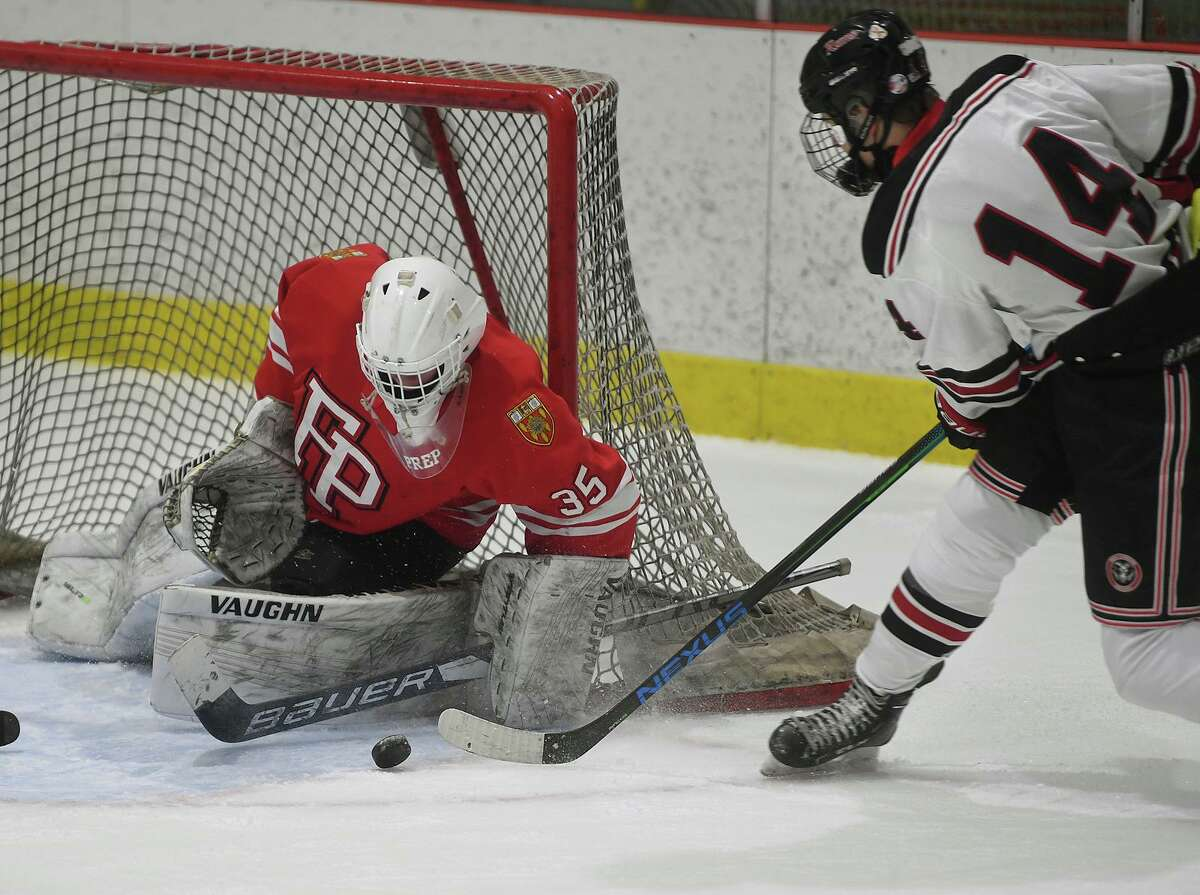 Fairfield Prep goalie makes a save on a point blank shot by New Canaan's Shane Mettler in the first period of their opening game of the FCIAC ice hockey season at the Darien Ice House in Darien, Conn. on Monday, February 8, 2021.