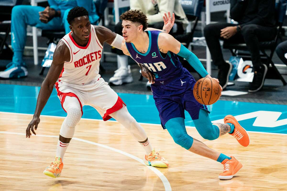 CHARLOTTE, NORTH CAROLINA - FEBRUARY 08: LaMelo Ball #2 of the Charlotte Hornets drives against Victor Oladipo #7 of the Houston Rockets during the second quarter at Spectrum Center on February 08, 2021 in Charlotte, North Carolina. NOTE TO USER: User expressly acknowledges and agrees that, by downloading and or using this photograph, User is consenting to the terms and conditions of the Getty Images License Agreement. (Photo by Jacob Kupferman/Getty Images)