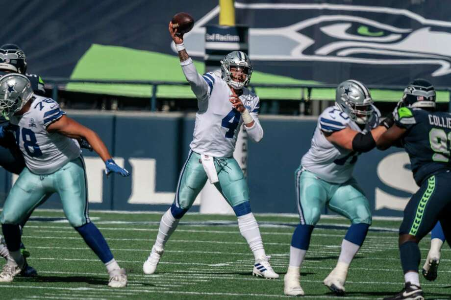 Dak Prescott's contract situation, or lack thereof, continues to be a cloud hanging over the Cowboys. Photo: Stephen Brashear /Associated Press File / Copyright 2020 The Associated Press. All rights reserved.