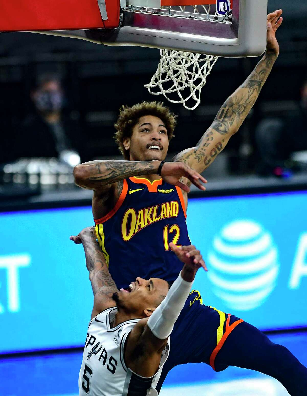 Dejounte Murray of the San Antonio Spurs has his layup foiled by Kelly Oubre (12) of the Golden State Warriors during first-half NBA action in the AT&T Center on Monday, Feb. 8, 2021.