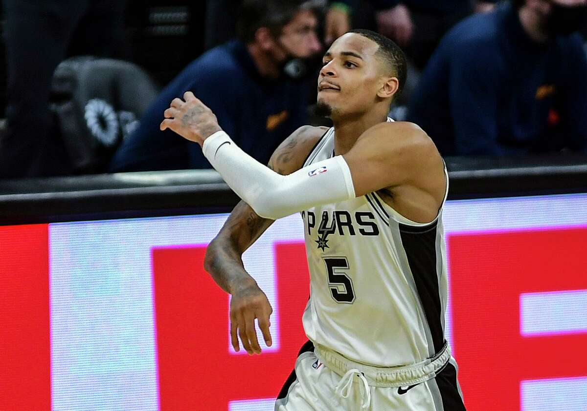Dejounte Murray of the San Antonio Spurs reacts after scoring on a three-point shot late in the fourth quarter against the Golden State Warriors in NBA action in the AT&T Center on Monday, Feb. 8, 2021.