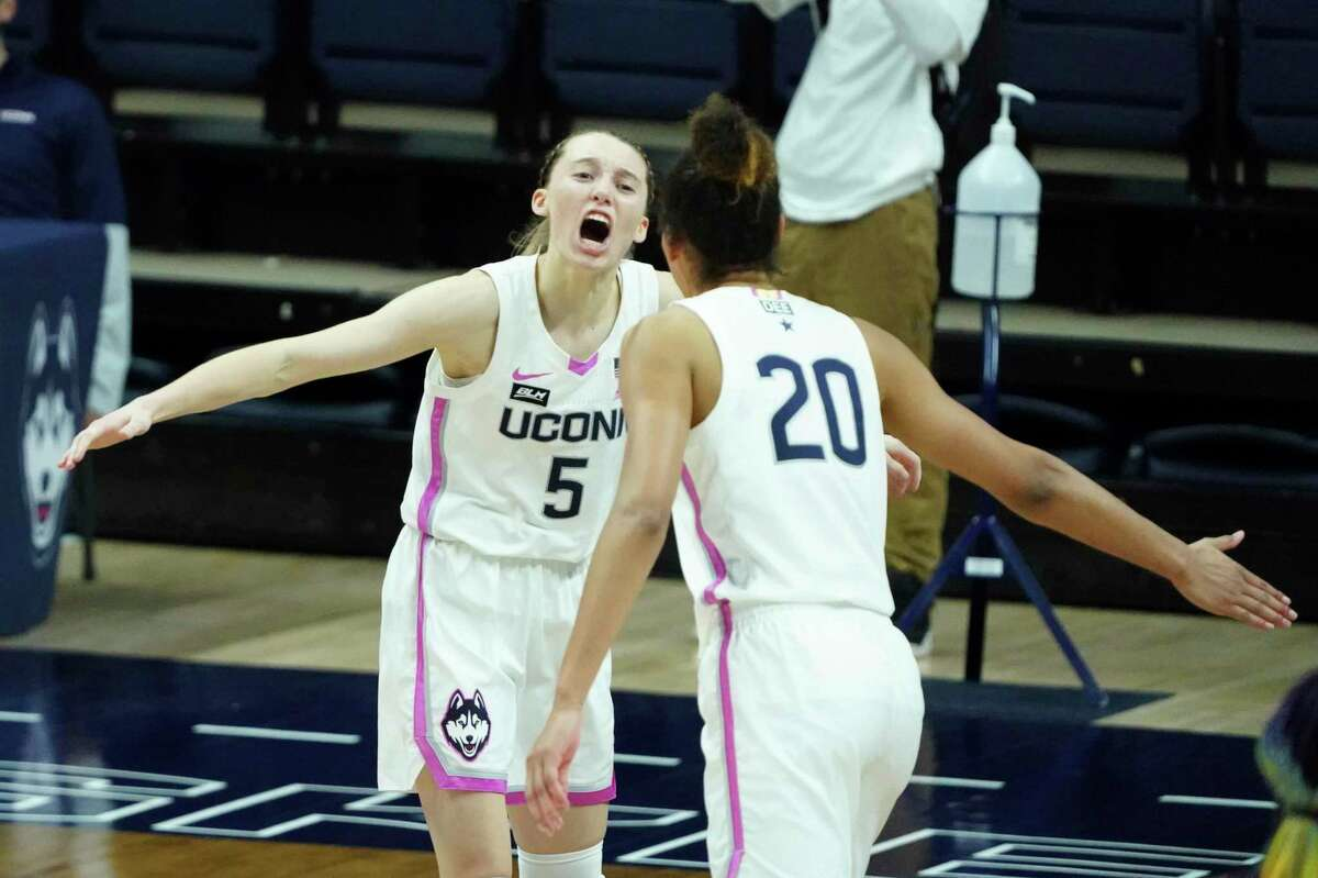 UConn's Paige Bueckers (5) celebrates with Olivia Nelson-Ododa after her 3-point basket during Monday night's overtime win over No. 1 South Carolina in Storrs.