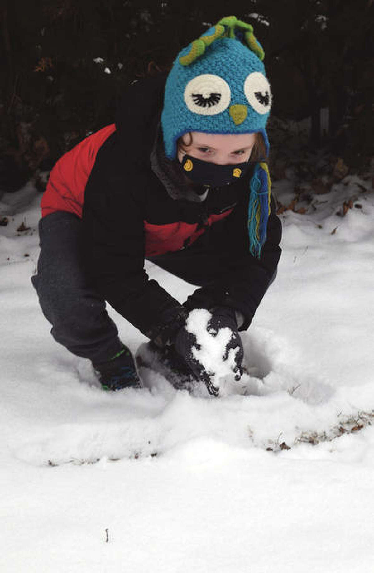 Ben Calaway-Camacho, 7, the son of Jared Calaway and Stacy Camacho of Jacksonville, makes a snowball Monday.