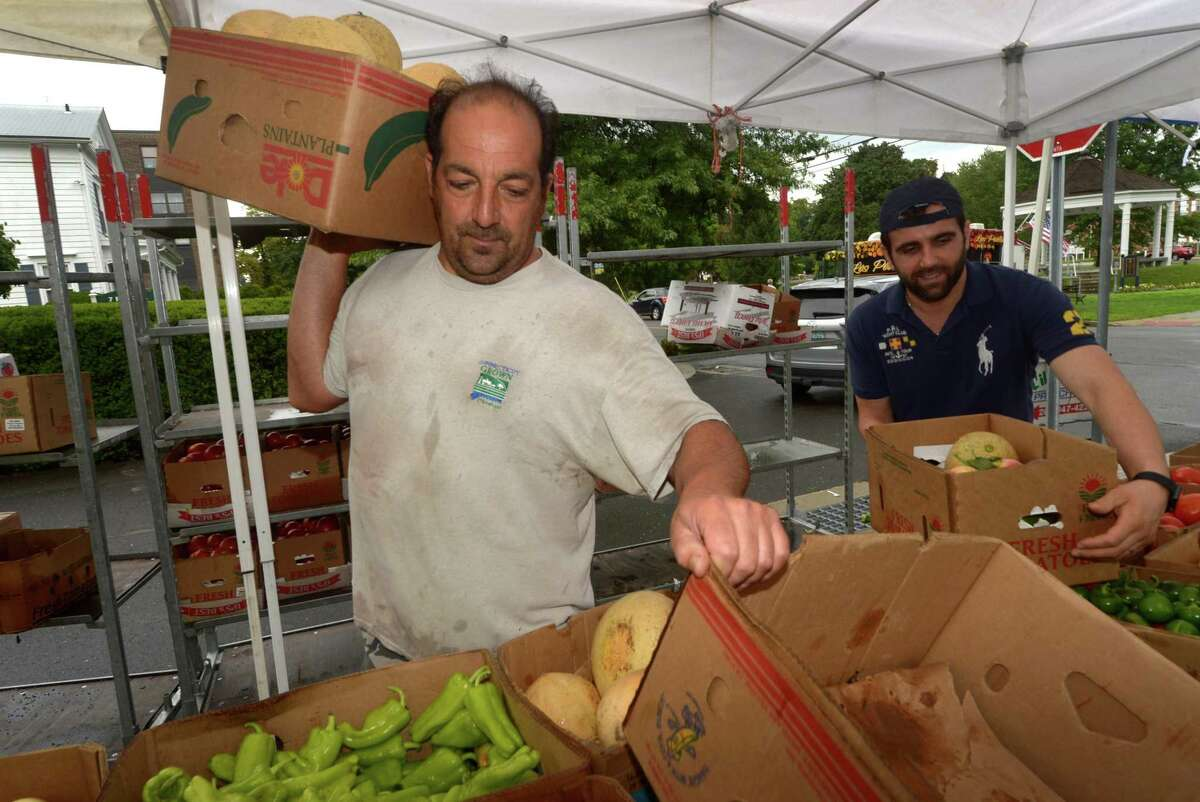 Country Farms proprietor Tony Viglio stocks melons during the First Congregational Church Farmer's Market Saturday, August, 11, 2018, at the church in Norwalk, Conn the First Congregational Church Farmer's Market is hosted by Norwalk Green Association adn offers discounts for EBT recipients and runs through October.