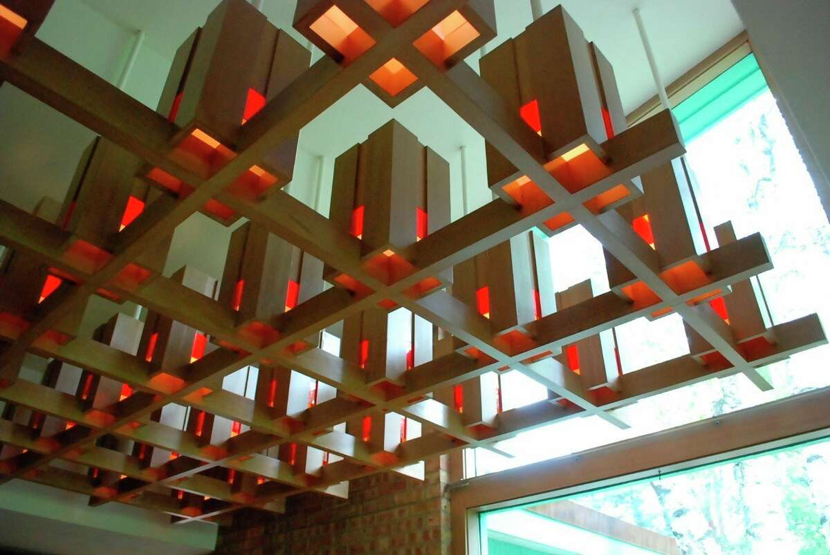 Alden B. Dow designed wood and red glass chandelier that is recessed into the dining room ceiling. (Photo provided)