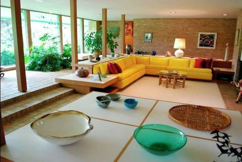 """The Bennett House living room that features the surrounding """"gallery"""" space looking onto hole number three of the golf course. (Photo provided)"""