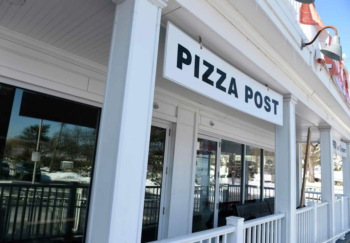 Pizza Post readies for re-opening in the Cos Cob section of Greenwich, Conn. Monday, Feb. 8, 2021. Owner Matthew Criscuolo has been working to renovate and expand the space since a fire destroyed it in 2019 and hopes to reopen this month.