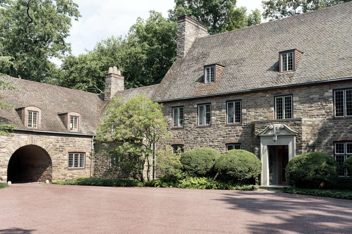 The 13,063-square-foot house at 23 Khakum Wood Road, Greenwich sits on a nearly nine-acre property.