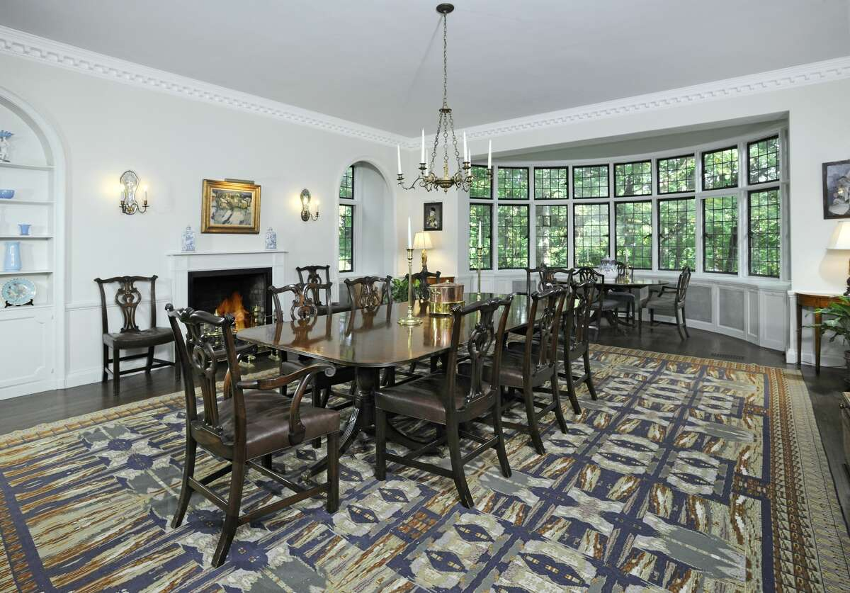 Banquet-sized formal dining room with fireplace at 23 Khakum Wood Road, Greenwich.