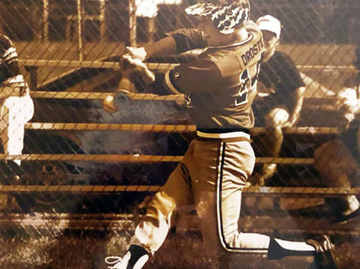 Edwardsville's John Droste, a 1991 EHS graduate and a member of the Tigers' 1990 Class AA state championship team, swings at a pitch during a game.