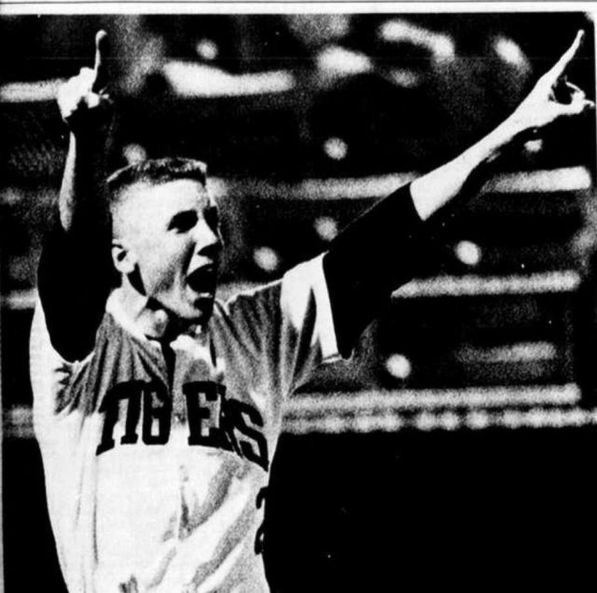 Edwardsville's John Droste celebrates after the Tigers beat Joliet Catholic in 1990 to win the Class AA baseball championship.