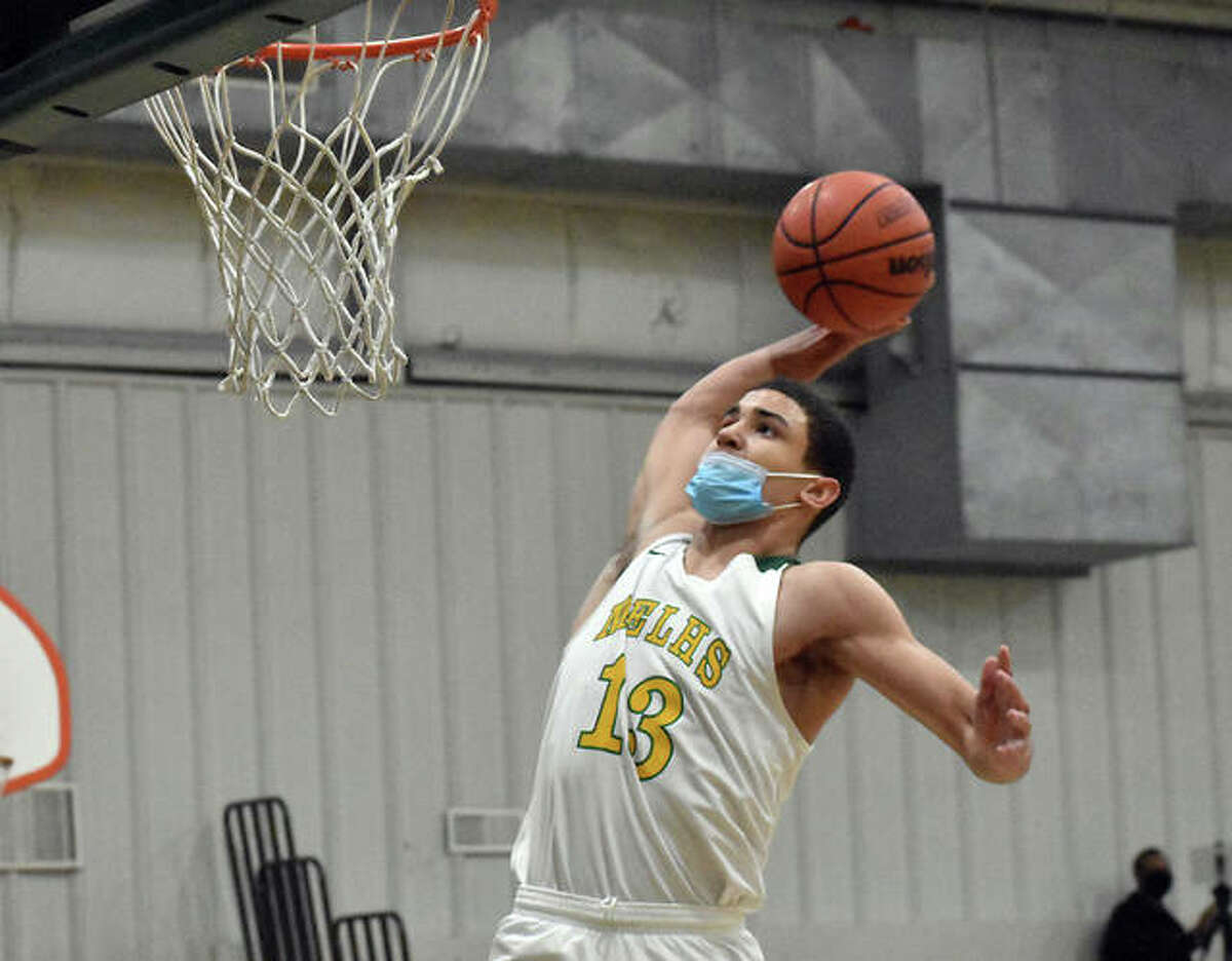 Metro-East Lutheran's AJ Smith goes up for one of his four dunks during Monday's game against Father McGivney in Edwardsville.