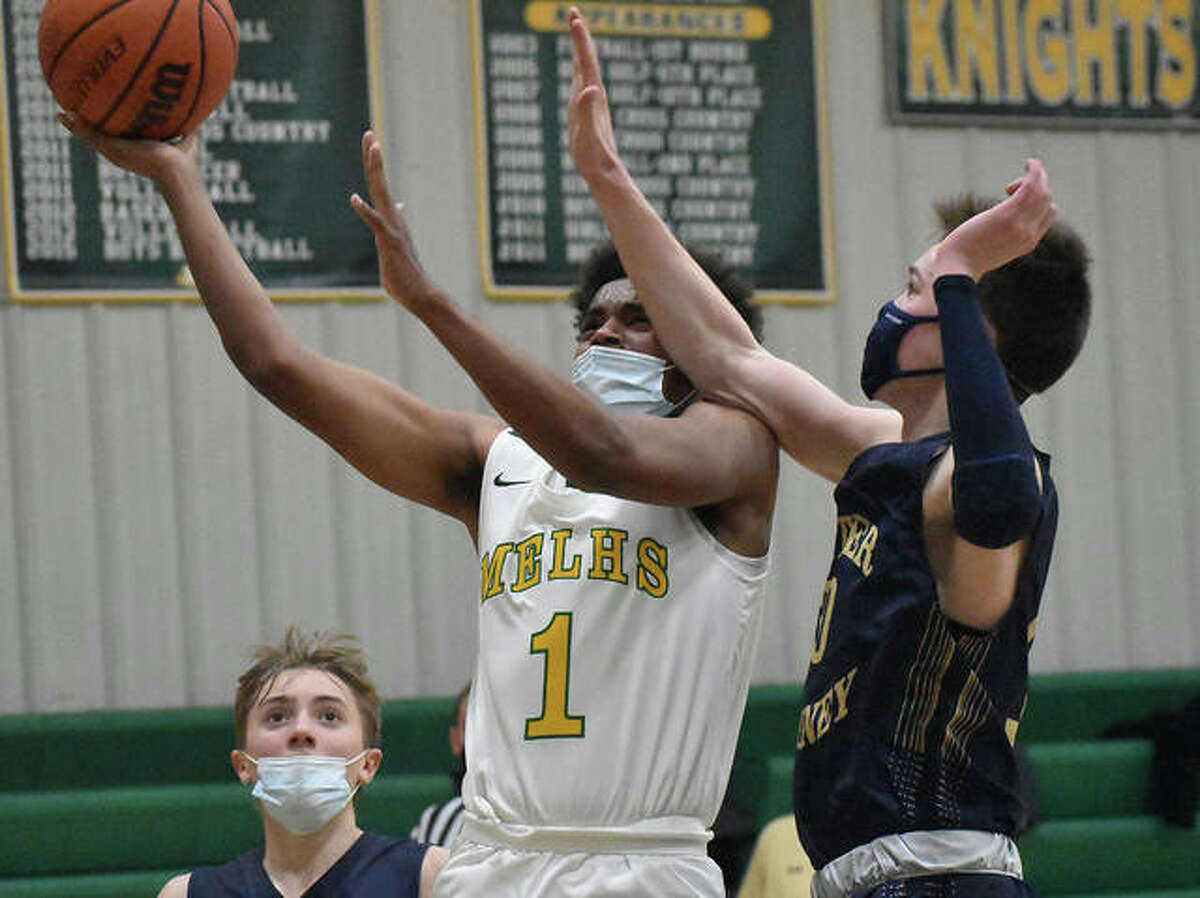 Metro-East Lutheran's Zion Tucker splits Father McGivney's Jacob Huber, left, and Jackson Rodgers, right, for a contested shot Monday.