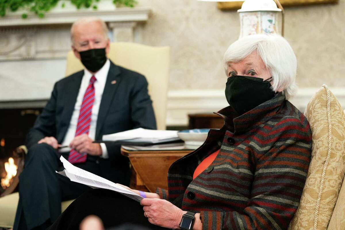 Treasury Secretary Janet Yellen responds to reporters before the start of an economic briefing with President Joe Biden, left, and Vice President Kamala Harris, not shown, in the Oval Office of the White House in Washington on Friday, Jan. 29, 2021.