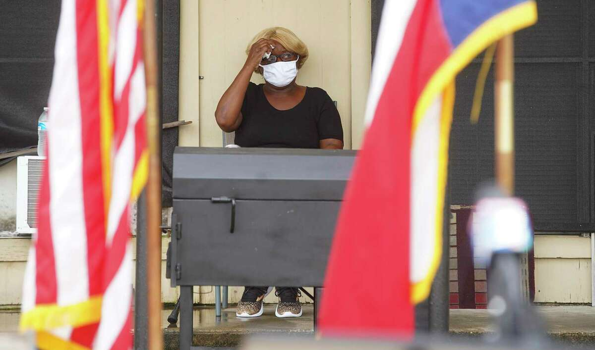 Judy Phillips, wipes her brow as she waits outside her apartment for a press conference with U.S. Rep. Sheila Jackson Lee at Spanish Village Apartments in Houston on Tuesday, Sept. 8, 2020. Phillips, who has cancer, was scheduled to be evicted today, but was able to stay with the help of Rep. Jackson Lee.