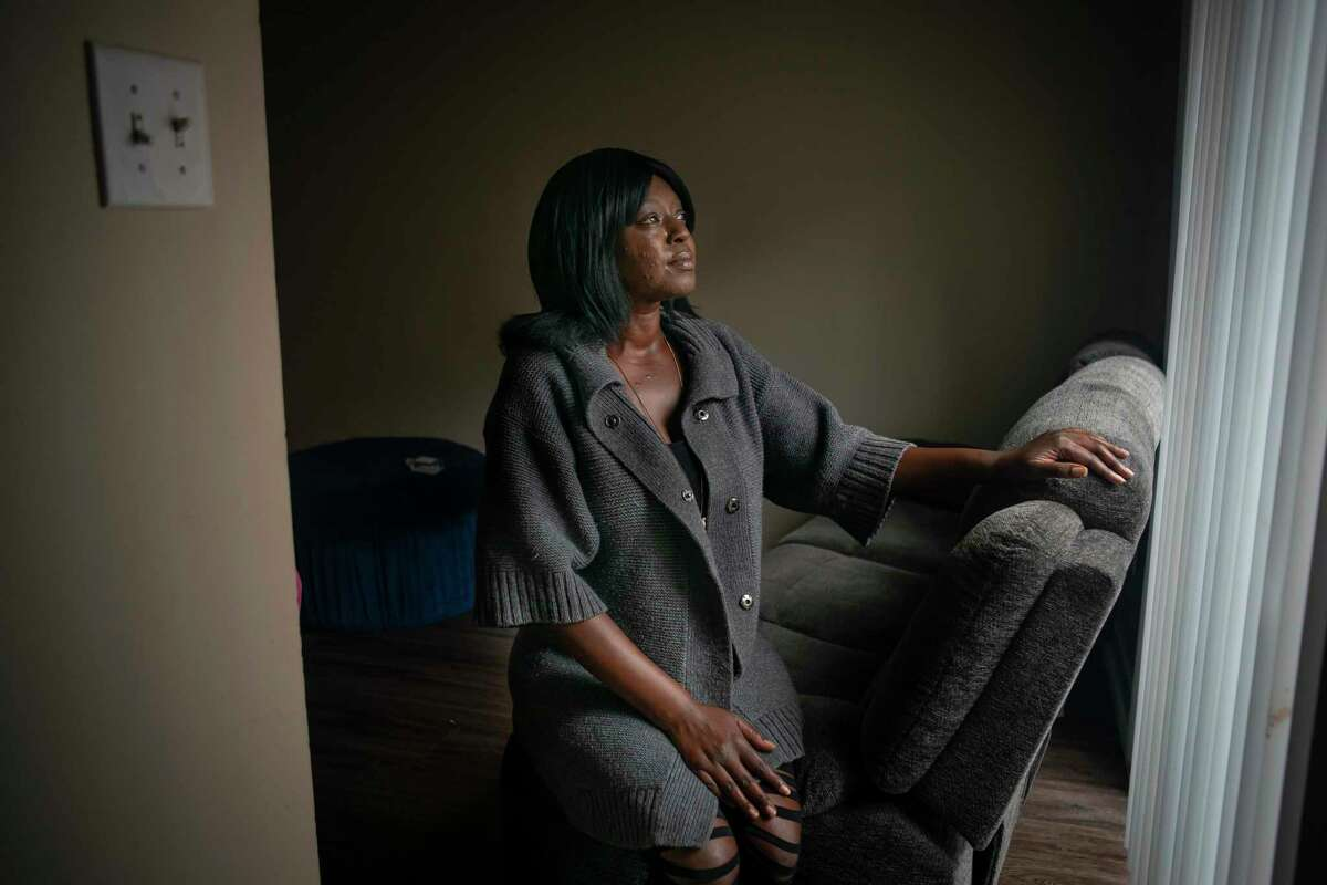 Lylian Walk speaks from inside her apartment where she is facing eviction after making an incomplete rent payment after losing her job earlier this year. Evictions are currently on hold in the county due to the coronavirus pandemic. Photographed Tuesday, May 12, 2020, at in Houston.