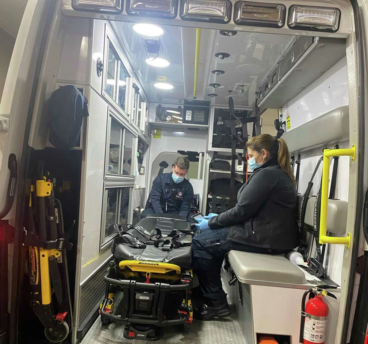 Echo Hose volunteer EMT's Stephen Jones and Randee Hennequin check their ambulance at the start of their shift on Monday,.