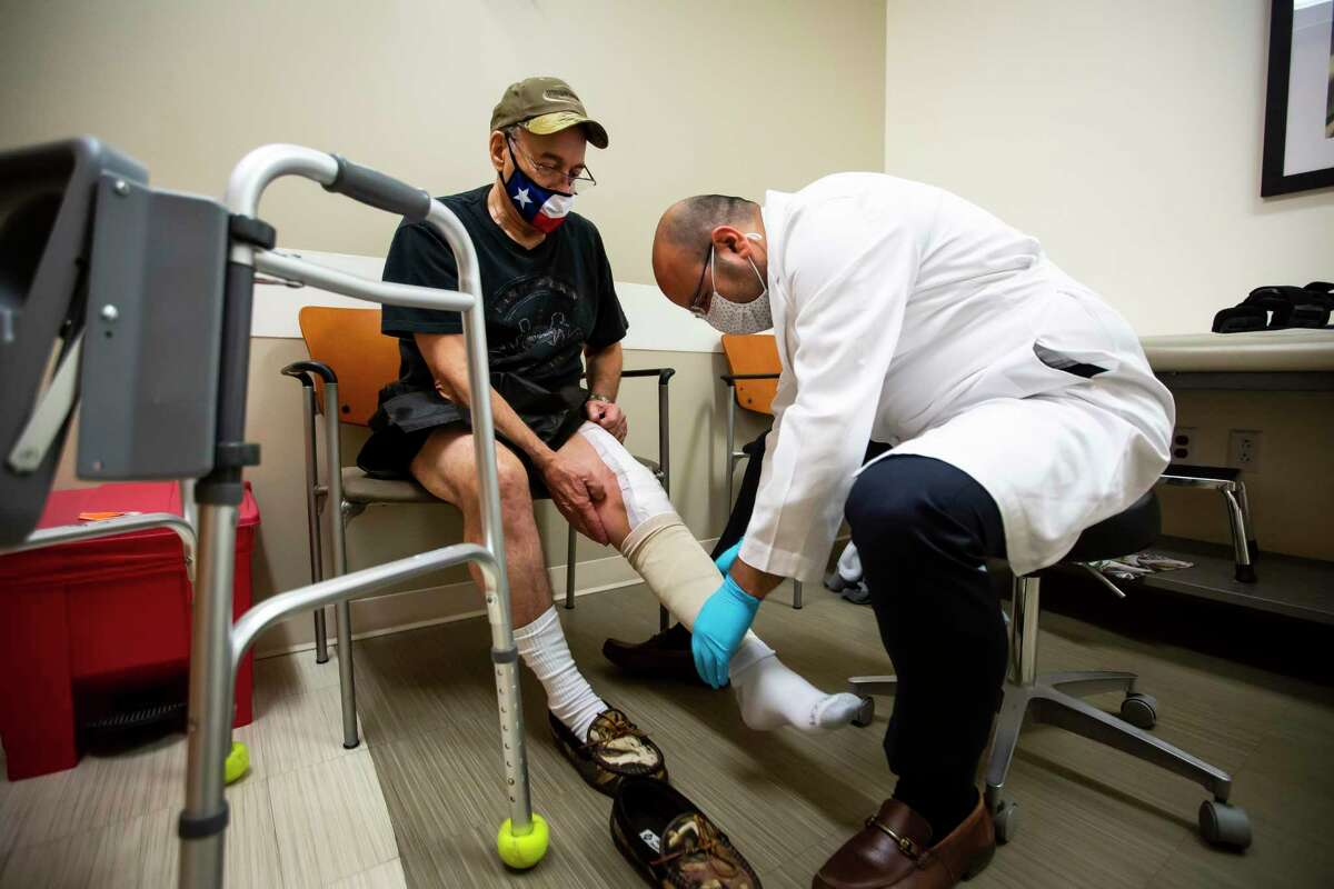 Billy Moreton sits as his knee is unwrapped during a post-surgery checkup with Dr. Mohamad Halawi at the McNair Campus of Baylor St. Luke's Medical Center in Houston on Friday, Feb. 5, 2020. Dr. Halawi opposes prescribing opioids to patients for post surgery recovery and is pushing for other physicians to do the same.