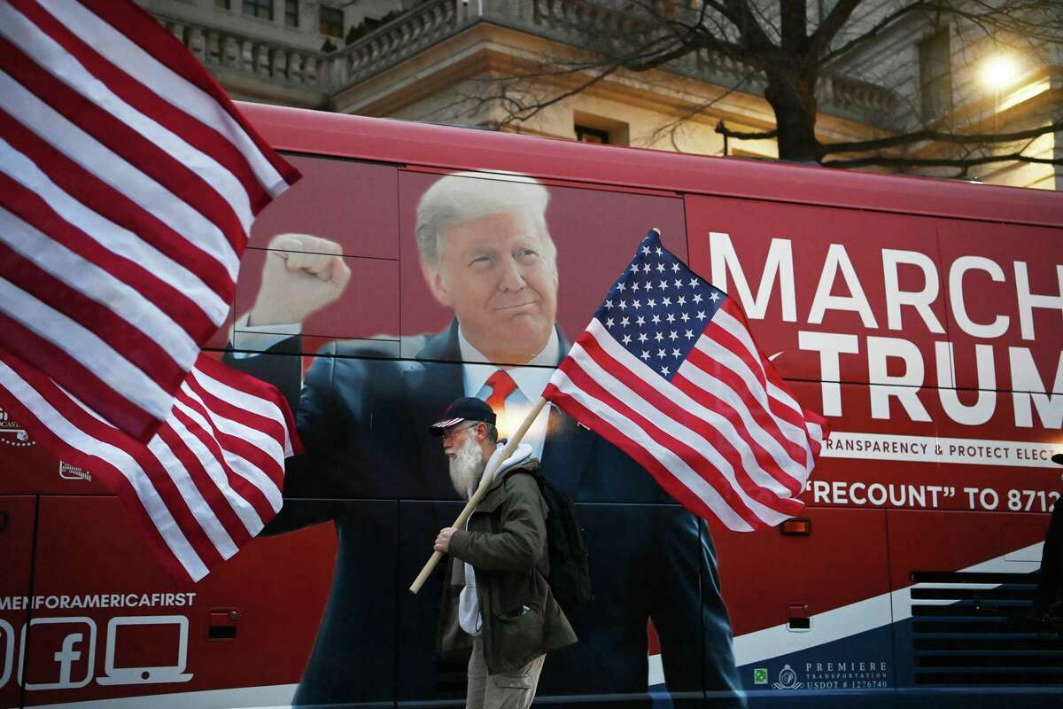 A supporter of President Donald Trump walks toward the