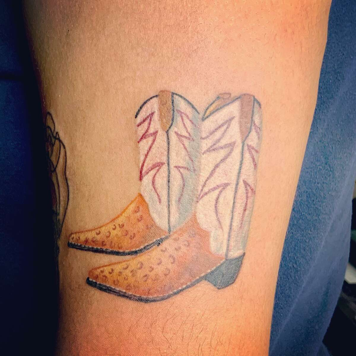 North Star Mall's pair of gigantic cowboy boots have a tiny, tattooed twin on the arm of a San Antonio woman.