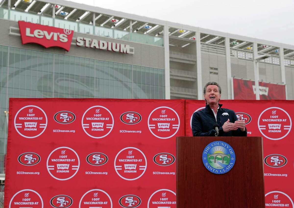 California Gov. Gavin Newsom speaks at Levi's Stadium on Tuesday as the mass-vaccination site opened.