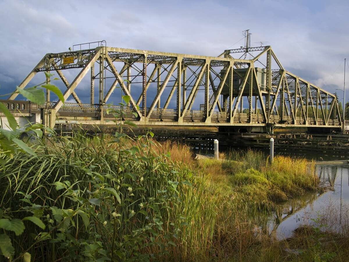 View of bridge over Ebey Slough against blue sky, Marysville, Washington.