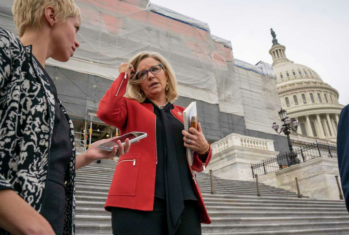 In this Jan. 10, 2020 photo, Rep. Liz Cheney, R-Wyo., speaks with reporters as lawmakers leave the Capitol in Washington.