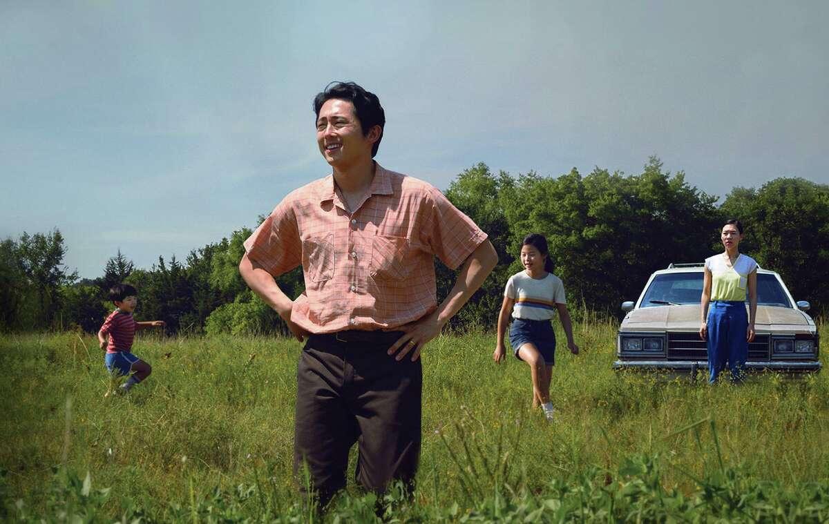 "Alan S. Kim, left, Steven Yeun, Noel Cho and Yeri Han in A24's ""Minari."" (David Bornfriend/A24/TNS)"