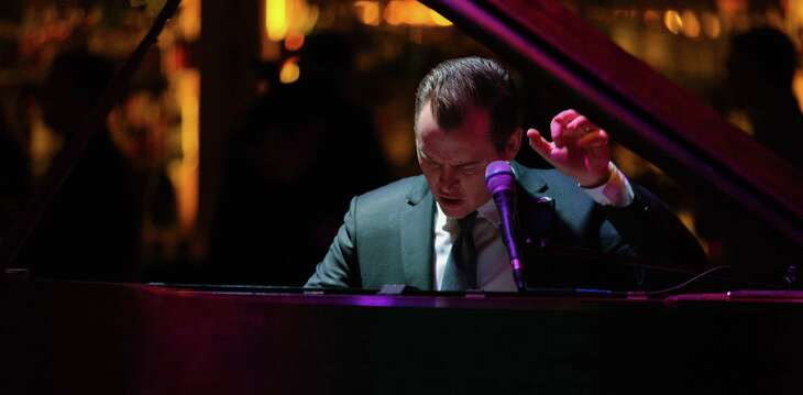 Pianist and restaurateur Doc Watkins, shown playing before the pandemic, has reopened his club, Jazz TX.