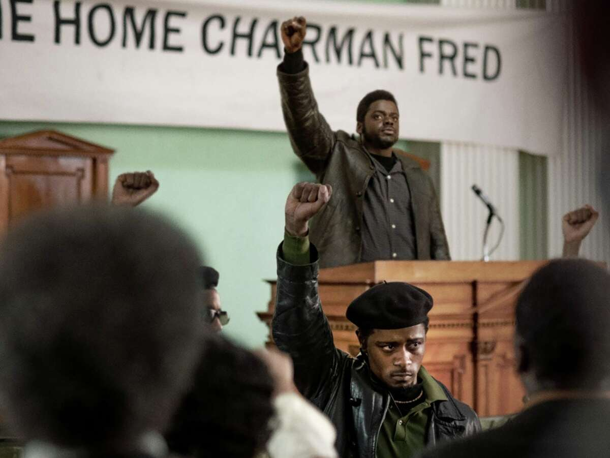 """LaKeith Stanfield, foreground, and Daniel Kaluuya, behind the lectern, star in """"Judas and the Black Messiah."""""""