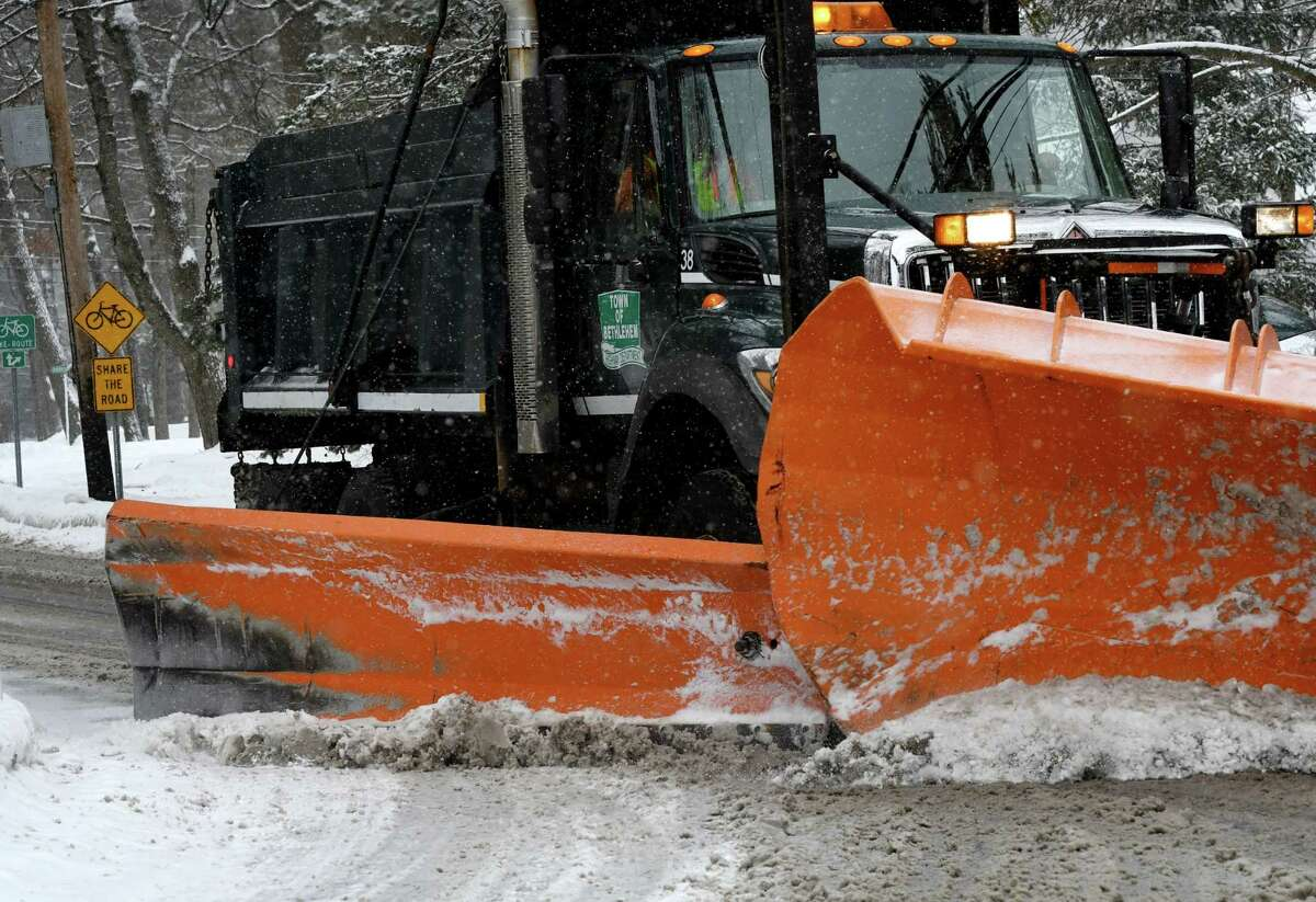 A Town of Bethlehem plow clears snow along Winne Road on Tuesday, Feb. 9, 2021, in Delmar, N.Y. There is a push to get other government essential workers prioritized for coronavirus vaccine - like public works employees. (Will Waldron/Times Union)
