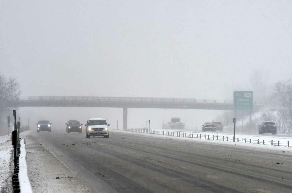 Traffic navigates through across a layer of slushy snow on Route 7 on Tuesday, Feb. 9, 2021, in Colonie, N.Y. (Will Waldron/Times Union)