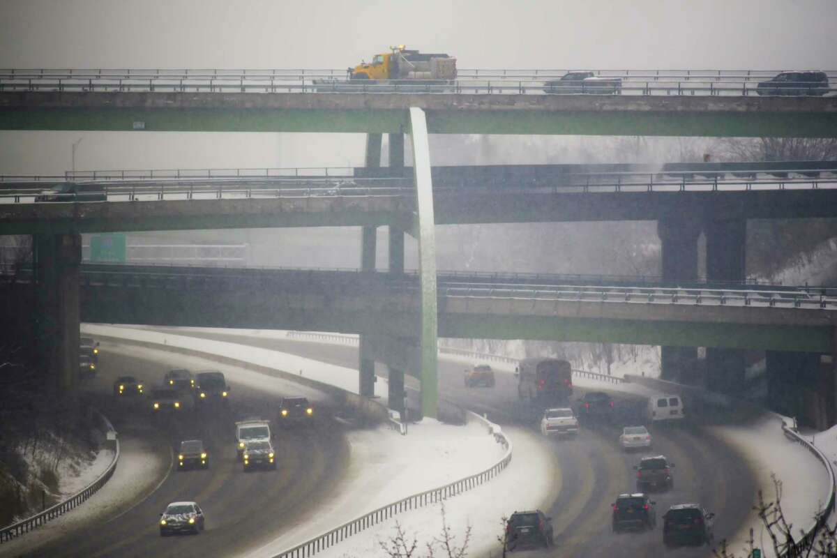 A snowplow clears snow off of the Route 9 bridge over Interstate 90 on Tuesday, Feb. 9, 2021, in Albany, N.Y. More snow is expected Feb. 15 into Feb. 16, 2021. (Paul Buckowski/Times Union)