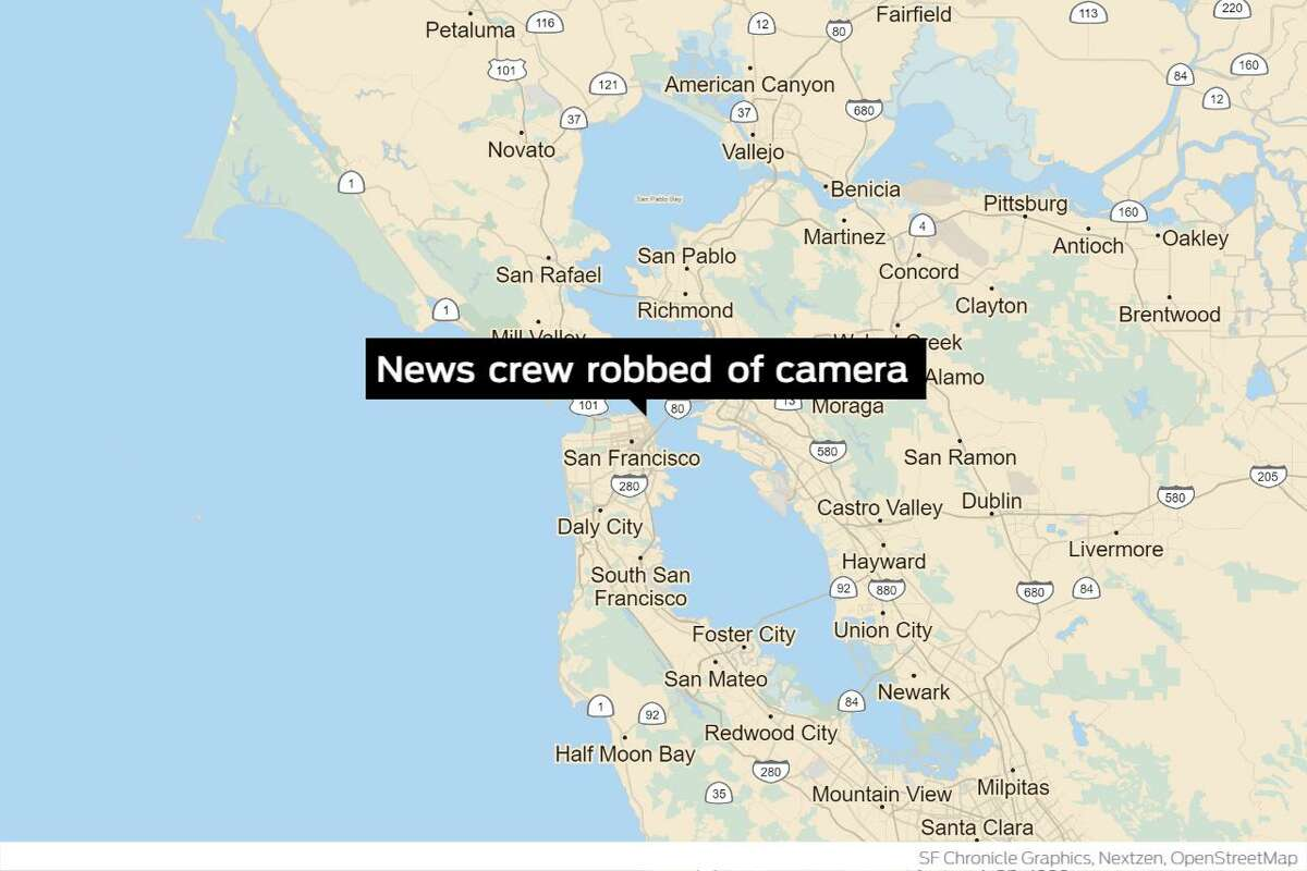 San Francisco police arrested two men for allegedly robbing a local television news crew's camera last week near the eastbound I-80 Bay Bridge Ramp.