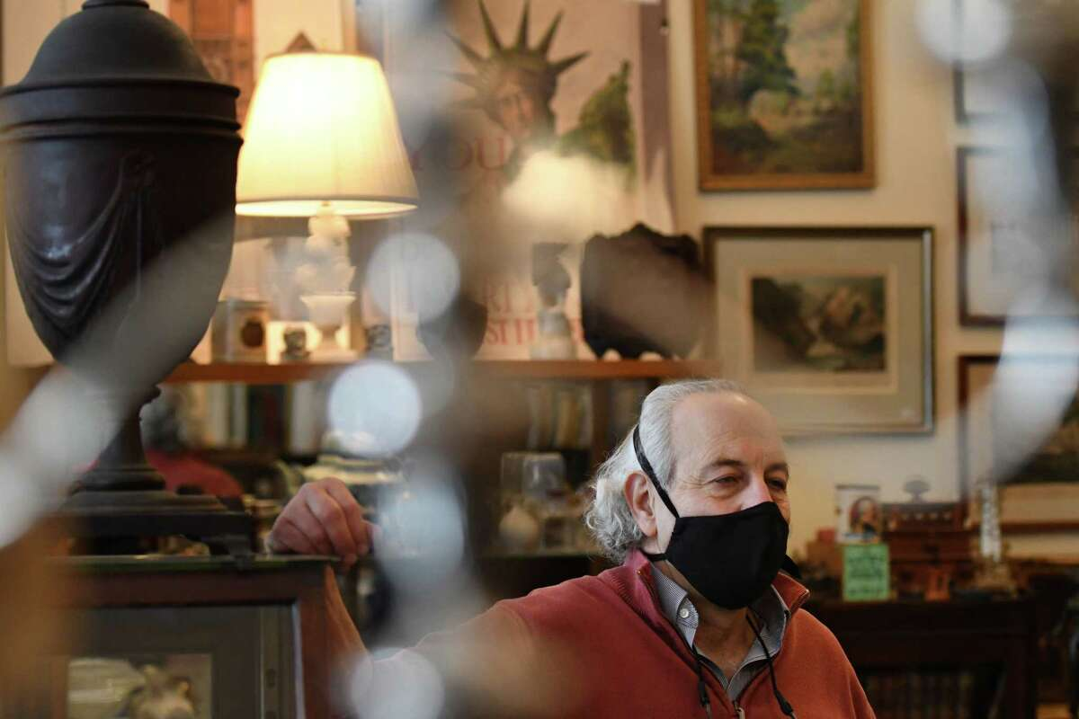 Dennis Holzman, proprietor of Dennis Holzman Antiques, at his Remsen Street store on Tuesday, Feb. 9, 2021, in Cohoes, N.Y. Holzman has been selling antiques for use in HBO's 'The Gilded Age series.' (Will Waldron/Times Union)